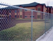 •	Gregory Fence Commercial Chain Link Fencing Around a School